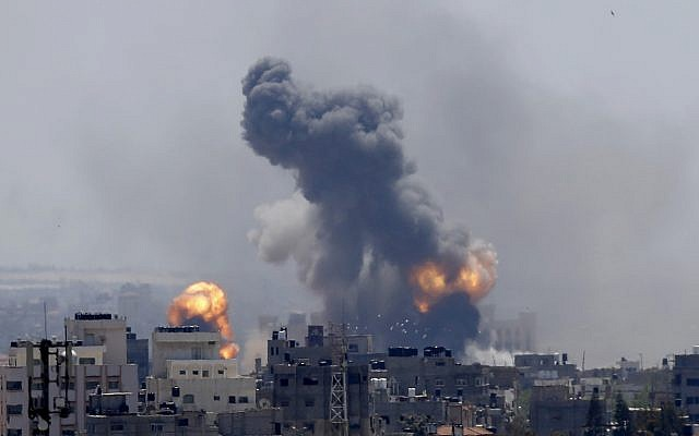 Smoke rises from an explosion caused by an Israeli airstrike in Gaza City, Saturday, May 4, 2019 (AP Photo/Hatem Moussa)