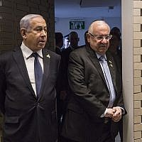 Prime Minister Benjamin Netanyahu, left, and President Reuven Rivlin arrive for a Memorial Day ceremony in Mount Herzl, Jerusalem on May 8, 2019. (Heidi Levine/Pool via AP).
