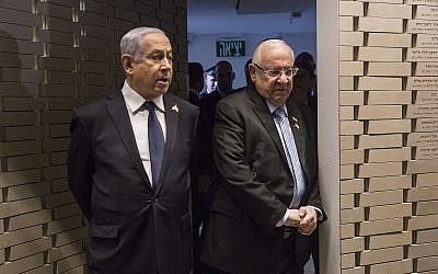 Prime Minister Benjamin Netanyahu, left, and President Reuven Rivlin arrive for a Memorial Day ceremony in Mount Herzl, Jerusalem on May 8, 2019. (Heidi Levine/Pool via AP).