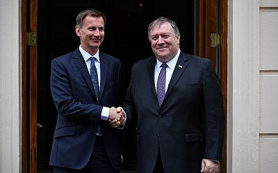 US Secretary of State Mike Pompeo, right, is greeted by Britain's Foreign Secretary Jeremy Hunt in central London, May 8, 2019. (Mandel Ngan/Pool via AP)