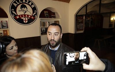 Francesco Polacchi, regional coordinator of Casapound far-right political party, and founder of Altaforte publishing company, answers to reporters during a news conference, in Milan, Italy, Wednesday, May 8, 2019.  (AP Photo/Luca Bruno)