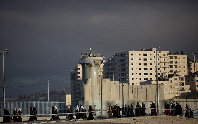 Palestinians walk towards the Qalandia checkpoint between the West Bank city of Ramallah and Jerusalem to attend the first Friday prayers in Jerusalem's al-Aqsa mosque on the Temple Mount, during the Muslim holy month of Ramadan, Friday, May 10, 2019.(AP Photo/Majdi Mohammed)