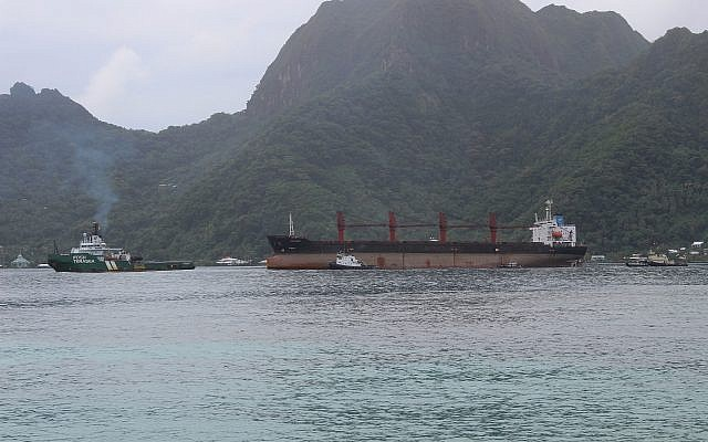 A North Korean cargo ship, Wise Honest, middle, that was towed into the Port of Pago Pago in the late morning on May 11, 2019, in Pago Pago, American Samoa. (AP Photo/Fili Sagapolutele)