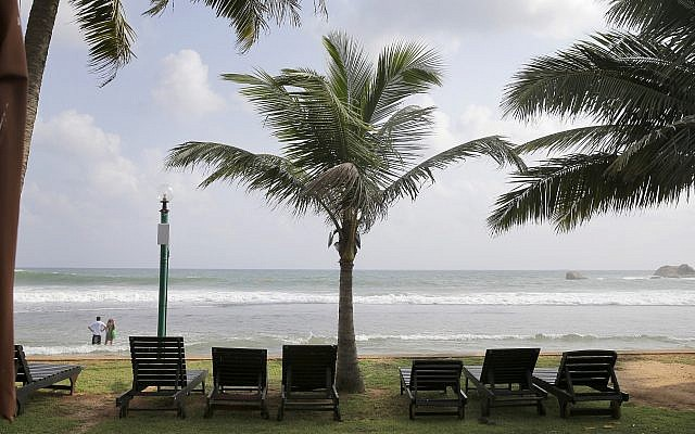 In this May 10, 2019, photo, lounge chairs lie on a deserted beach in Hikkaduwa, Sri Lanka (AP Photo/Eranga Jayawardena)