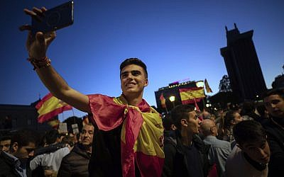 In this April 26, 2019 file photo, far-right Vox party supporters attend an election campaign event in Madrid, Spain (AP Photo/Bernat Armangue)