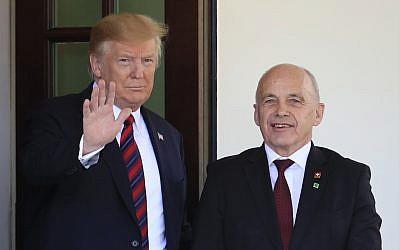 President Donald Trump welcomes Switzerland's Federal President Ueli Maurer to the White House in Washington, May 16, 2019. (AP Photo/Manuel Balce Ceneta)