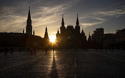 People walk on Red Square enjoying a sunset in Moscow, Russia, May 16, 2019. (AP Photo/Alexander Zemlianichenko)