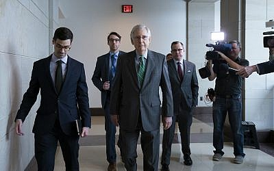 Senate Majority Leader Mitch McConnell, R-Ky., passes reporters as he and other top congressional leaders head to a classified briefing on Iran after members of both parties asked for more information on the White House's claims of rising threats in the Middle East, at the Capitol in Washington, Thursday, May 16, 2019. (AP/J. Scott Applewhite)