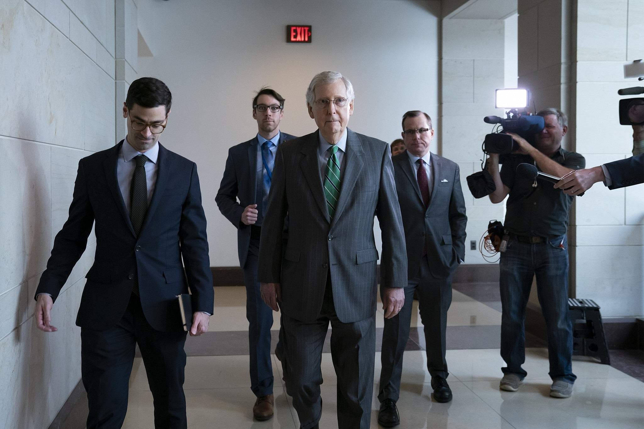 Senate Majority Leader Mitch McConnell R-Ky. passes reporters as he and other top congressional leaders head to a classified briefing on Iran after members of both parties asked for more information on the White House's claims of rising threats