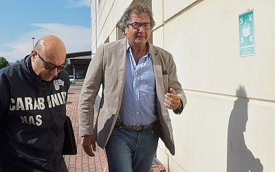 Dr. Guido Fanelli (right) entering police headquarters in Parma, Italy, for questioning in an alleged pharmaceutical kickback scheme, May 8, 2017. (AP/Marco Vasini)