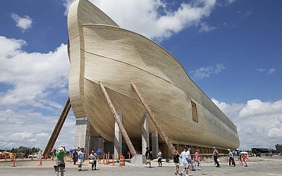 In this July 5, 2016, file photo, visitors pass outside the front of a replica Noah's Ark at the Ark Encounter theme park during a media preview day, in Williamstown, Kentucky. (AP Photo/John Minchillo, File)