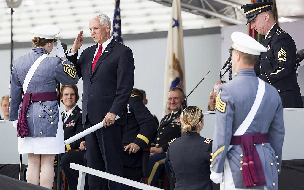 Vice President Mike Pence salutes a graduating cadet before handing a diploma to her during graduation ceremonies at the United States Military Academy, Saturday, May 25, 2019, in West Point, New York. (AP Photo/Julius Constantine Motal)