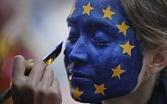 A woman has her face painted as the EU flag outside the European Parliament in Brussels, May 26, 2019, as voters from 21 nations voted on the final day of European Parliament elections. (AP /Francisco Seco)