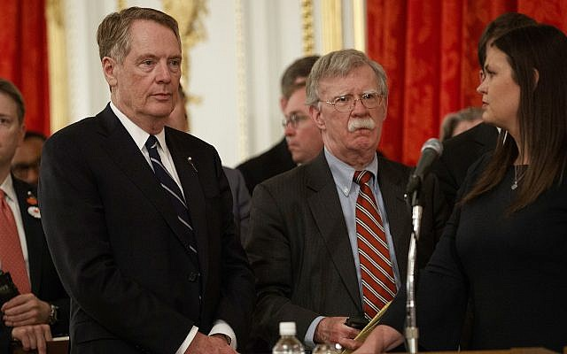 U.S. national security adviser John Bolton (center), Trade Representative Robert Lighthizer (left) and White House press secretary Sarah Sanders at a news conference with President Donald Trump and Japanese Prime Minister Shinzo Abe, May 27, 2019, in Tokyo. (AP/Evan Vucci)