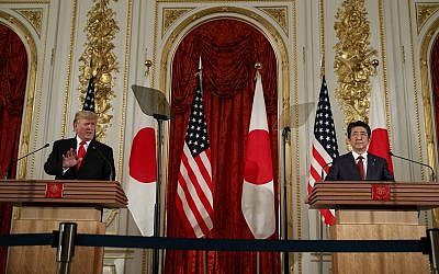 US President Donald Trump speaks during a news conference with Japanese Prime Minister Shinzo Abe, right, at Akasaka Palace in Tokyo on May 27, 2019. (AP Photo/Evan Vucci)