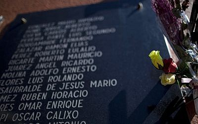 Illustrative: Plastic flowers sit placed on a memorial stone in tribute to Argentine soldiers who were killed during the Falklands war, in Buenos Aires, Argentina, April 8, 2013. (AP Photo/Natacha Pisarenko)