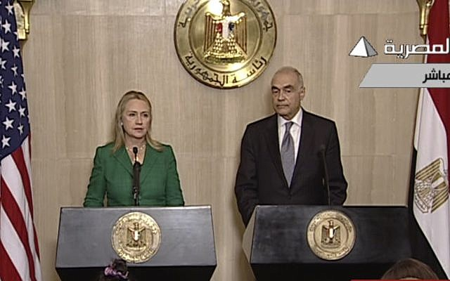 In this image made from Egyptian State Television, US Secretary of State Hillary Rodham Clinton, left, and Egyptian Foreign Minister Mohammed Kamel Amr, right, give a joint news conference announcing a cease-fire between Israel and Hamas in Cairo, Egypt on November 21, 2012. (AP Photo/Egyptian State Television)