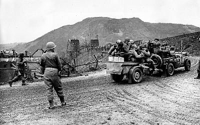 Illustrative: Troops of the 9th US Armored Division, First Army, advance across the intact Ludendorff Bridge to the east bank of the Rhine River in Remagen, Germany, on March 7, 1945 during World War II. (AP Photo/Allan Jackson)