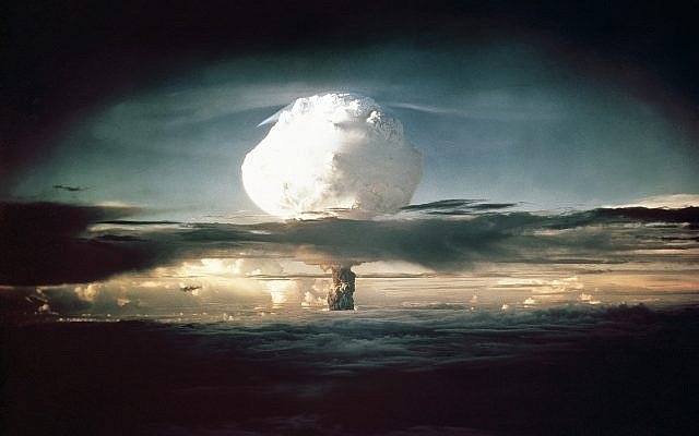 The mushroom cloud from Ivy Mike (codename given to the test) rises above the Pacific Ocean over the Enewetak Atoll in the Marshall Islands on November 1, 1952 at 7:15 am (local time). It was the world's first test of a full-scale thermonuclear device, in which part of the explosive yield comes from nuclear fusion. (AP Photo/Los Alamos National Laboratory)