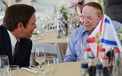 Florida Governor Ron DeSantis (L) talks to Republican donor Sheldon Adelson at a ceremony at Ariel University in the West Bank on May 27, 2019 where he was presented with the Honorary Fellowship Award for his dedication, leadership and commitment to the State of Israel (Courtesy/Governor's Press Office)