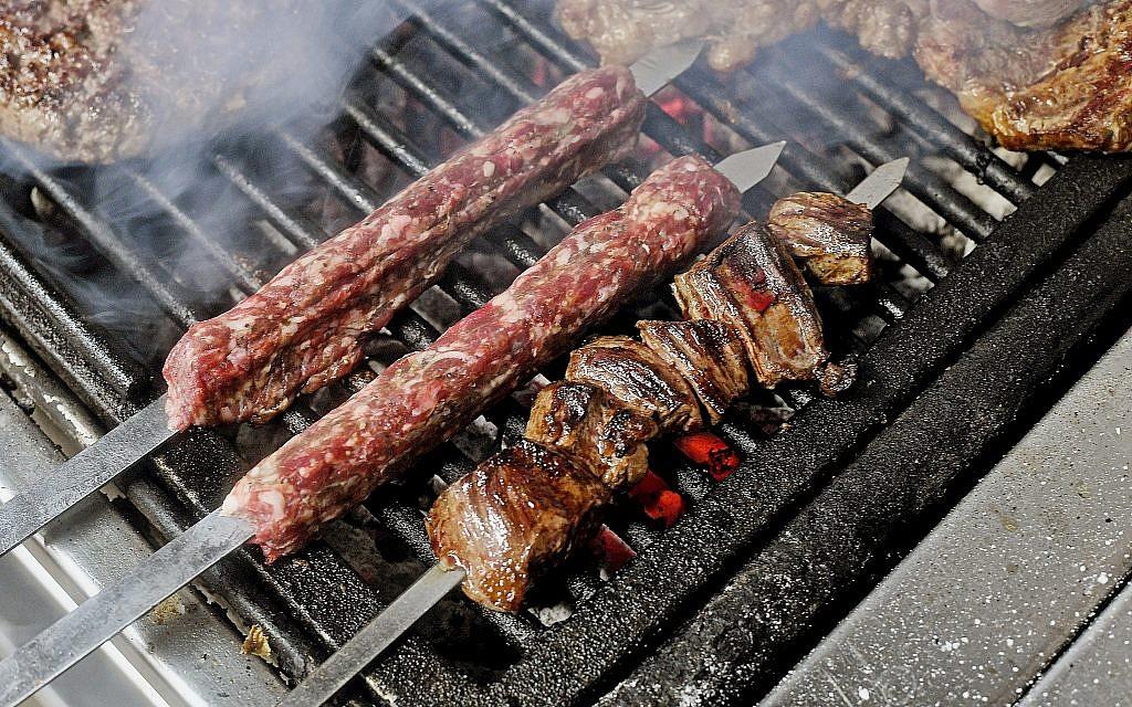 Skewers grilling M25 meat restaurant in Tel Aviv. (Ran Biran)