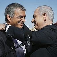 Backdropped by Jerusalem's Old City Walls, Prime Minister Benjamin Netanyahu (right) holds a press conference with Moshe Kahlon, one day before the general elections, January 21, 2013. (Miriam Alster/FLASH90)