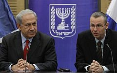 Prime Minister Benjamin Netanyahu and Likud member Yariv Levin are seen during a faction meeting at the Knesset on December 9, 2013. (Miriam Alster/Flash90)