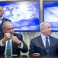 Prime Minister Benjamin Netanyahu (R) and Yisrael Beytenu leader Avigdor Liberman sign a coalition agreement in the Knesset on May 25, 2016. (Yonatan Sindel/Flash90)