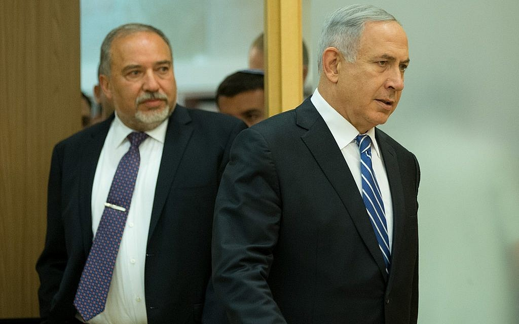 Prime Minister Benjamin Netanyahu (right) and Israel's then-new Defense Minister Avigdor Lieberman arrive at a joint press conference in the Knesset on May 30, 2016. (Yonatan Sindel/Flash90)