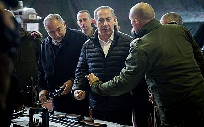 Illustrative: Prime Minister Benjamin Netanyahu (center) and Defense Minister Avigdor Liberman (right) view weapons in a Palestinian weapons factory discovered in the West Bank city of Hebron, during a visit to the IDF West Bank Division, near the Israeli settlement of Beit El. January 10, 2017. (Hadas Parush/FLASH90)