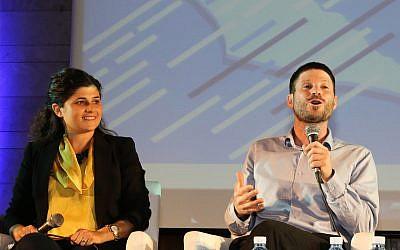 Likud MK Sharren Haskel (L) and Jewish Home MK Bezalel Smotrich speak at a conference in Jerusalem on May 27, 2018. (Gershon Elinson/ Flash90)