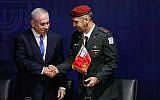 Prime Minister Benjamin Netanyahu (left) shakes hands with incoming IDF Chief of Staff Aviv Kohavi at IDF headquarters in Tel Aviv on January 15, 2019. (Flash90)