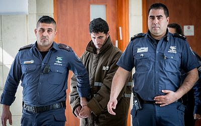 Arafat Irfaiya, charged with the rape and murder of 19-year-old Ori Ansbacher is brought for a hearing at the Jerusalem District court, on March 7, 2019. (Yonatan Sindel/Flash90)