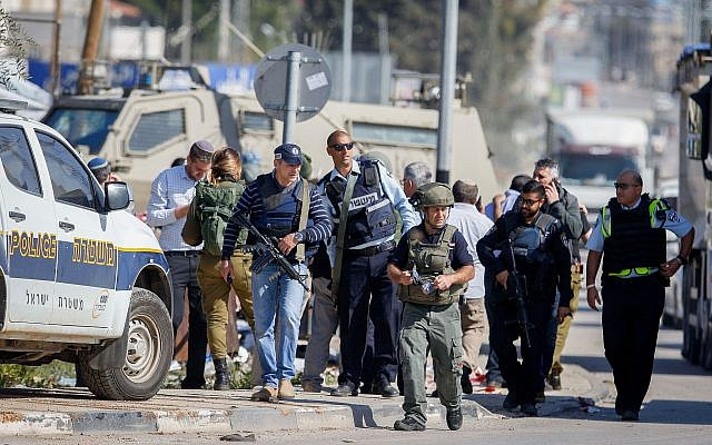 Illustrative: Israeli security forces at the scene of an alleged attempted stabbing attack at the Hawara checkpoint, south of the West Bank city of Nablus, April 3, 2019. (Nasser Ishtayeh/Flash90)