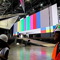 Workers prepare the stage ahead of the opening of the Eurovision Song Contest in Tel Aviv, on April 15, 2019 (Flash90)