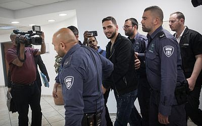 Netanel Sandrusi, suspected of being the driver who ran over an 11-year-old boy and then fled the scene is taken to court in Jerusalem, April 29, 2019. (Hadas Parush/Flash90)