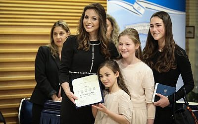 Blue and White MK Omer Yankelevich poses for a photo with her family ahead of the swearing-in of the 21st Knesset on April 30, 2019. (Noam Revkin Fenton/Flash90)