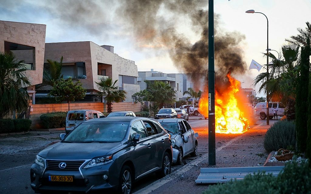 A car bursts into flames after it was hit by a rocket fired from the Gaza Strip in the southern Israeli city of Ashdod on May 5, 2019. (Flash90)