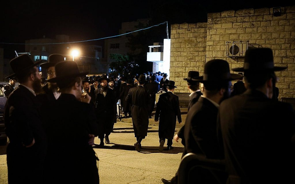 Ultra Orthoodx Jews stand outside the funeral of Pinchas Menahem Prezuazman in Jerusalem on May 5, 2019. Prezuazman was killed by shrapnel from a rocket fired from the Gaza Strip in Ashdod earlier Sunday . Hadas Parush/Flash90)