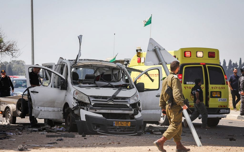 The scene of a car hit by a missile fired from the Gaza Strip near the Israel-Gaza border on May 5, 2019. (Noam Rivkin Fenton/Flash90)