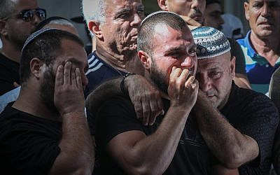 Friends and relatives mourn as they attend the funeral of 58-year-old Moshe Agadi, who was killed from shrapnel wounds after his house was hit directly by a rocket fired from the Gaza Strip in Ashkelon, southern Israel, on May 5, 2019. (Noam Rivkin Fenton/Flash90)