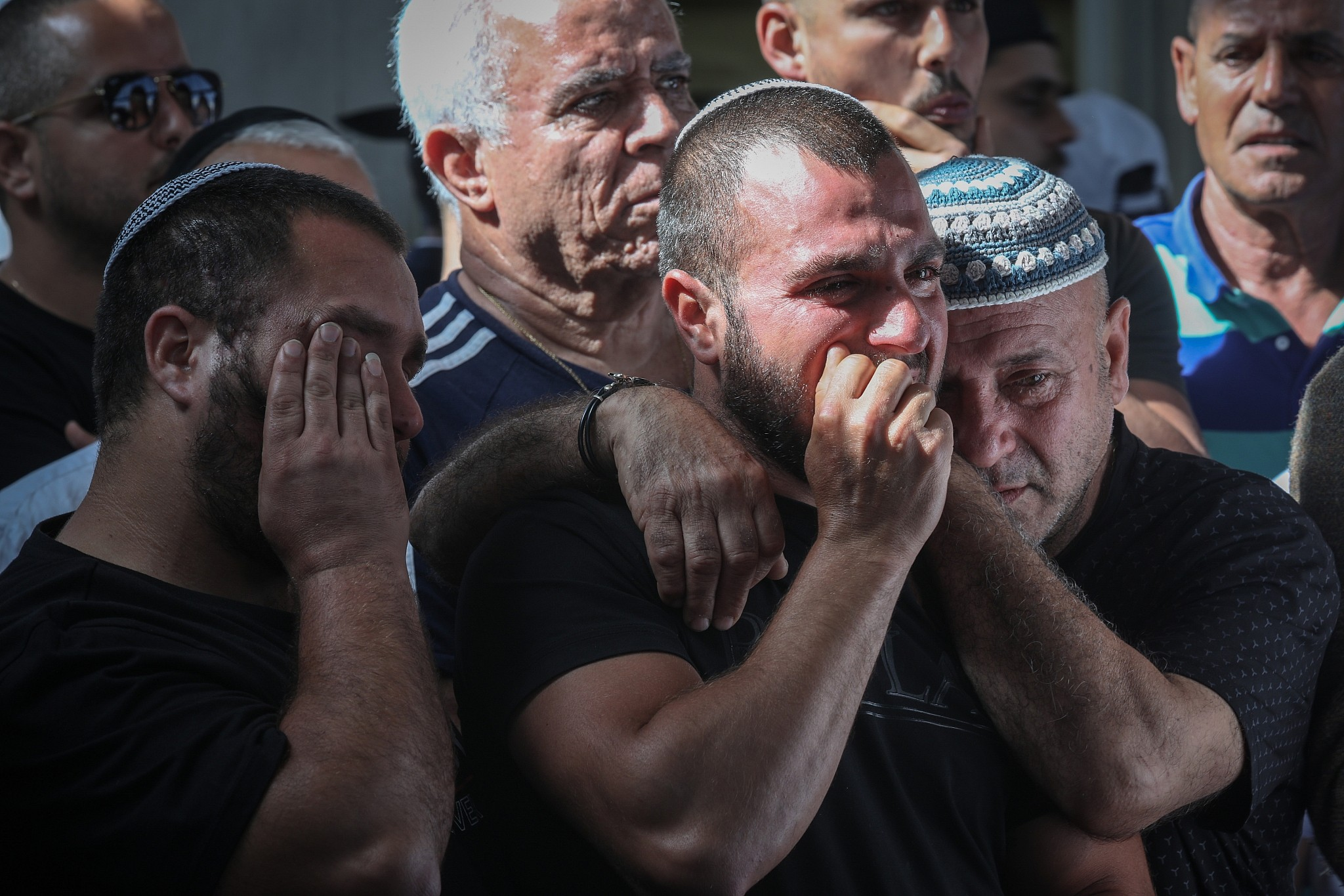 Friends and relatives mourn as they attend the funeral of 58-year-old Moshe Agadi who was killed from shrapnel wounds after his house was hit directly by a rocket fired from the Gaza Strip in Ashkelon southern Israel