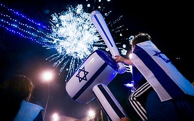 People watch fireworks during a show to mark Israel's 71st Independence Day in Jerusalem on May 8, 2019. (Hadas Parush/Flash90)