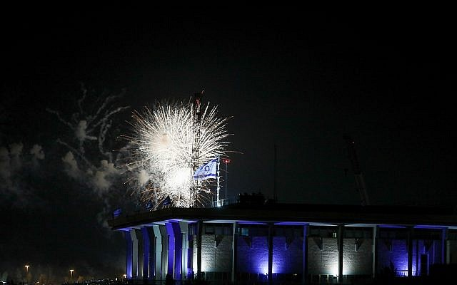 Fireworks from the Mount Herzl ceremony seen over the Knesset in Jerusalem, marking the beginning of celebrations of Israel's 71st Independence Day, on May 8, 2019 (Noam Revkin Fenton/Flash90)