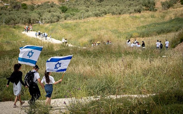 Israeli walk during a march to celebrate Israel's 71st Independence Day near Havat Gilad, in the West Bank on May 9, 2019. (Hillel Maeir/Flash90)