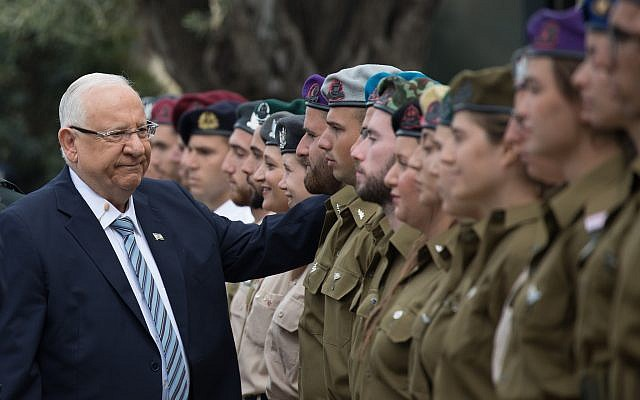 President Reuven Rivlin with outstanding soldiers during an event as part of Israel's 71st Independence Day celebrations, at the President's residence in Jerusalem on May 9, 2019. (Noam Revkin Fenton/Flash90)