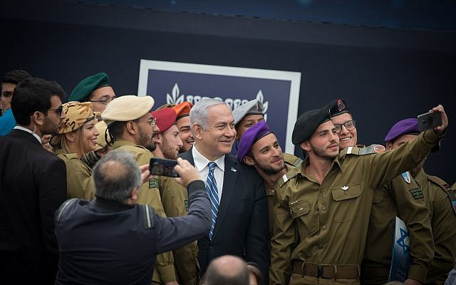 Prime Minister Benjamin Netanyahu, center, at an event for outstanding soldiers as part of Israel's 71st Independence Day celebrations, at the President's residence in Jerusalem on May 9, 2019. (Noam Revkin Fenton/Flash90)