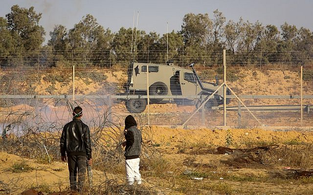 Illustrative: Palestinians clash with Israeli forces near the border fence between the Gaza Strip and Israel on May 10, 2019. (Abed Rahim Khatib/Flash90)