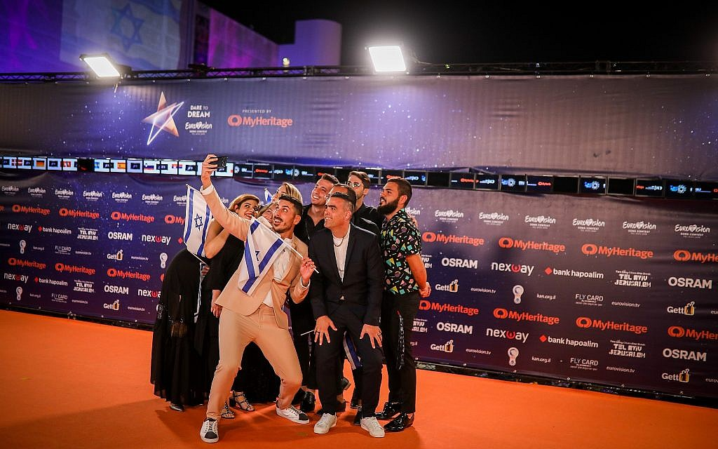 Israeli contestant Kobi Marimi walks on the Orange Carpet, during the opening event of the 2019 Eurovision Song Contest, at Habima Square in Tel Aviv on May 12, 2019. (Hadas Parush/Flash90)