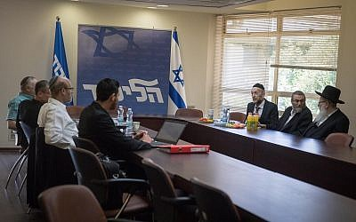 Members of the Likud and United Torah Judaism parties hold coalition negotiations at the Knesset on May 20, 2019. (Hadas Parush/Flash90)